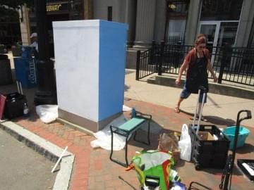 Priming the electrical box to prepare for painting
