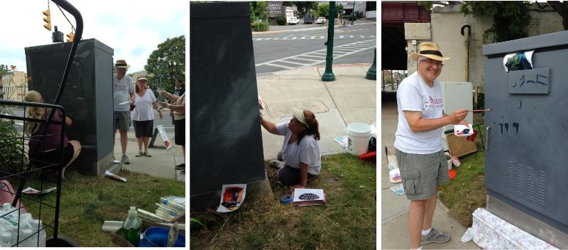 Painting the electrical box on Erie Blvd and Union Street near train tracks