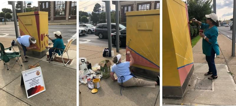 Painting the electrical box on State Street and Brandywine Avenue