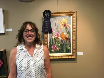 Amy Bergeron standing in front of her 1st place painting