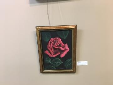 close up of a painting of a pink rose